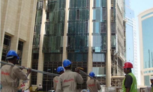 Hamton International Engineering LLC Doha, Qatar - Men working ifront of the building